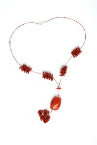 Pendentif toupies tagua rouge